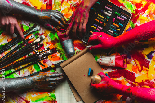 Hands, paint, art in art studio, colorful creative background Fototapet