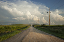 Rural Road With Dramatic Clouds In Southern Minnesota At Sundown