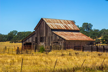 Vintage Wooden Barn With Rusty Tin Roof