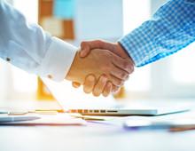 Businessmen Shaking Hands In T...