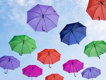 Many Umbrellas Against Blue Sky.