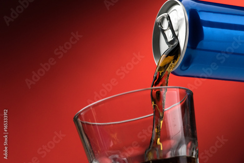Fotografie, Obraz  Pouring a soft drink in a glass