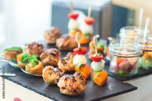 Spoed Foto op Canvas Voorgerecht Decorated catering banquet table with different food appetizers assortment on a party