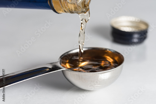 Pouring Sherry into a Teaspoon