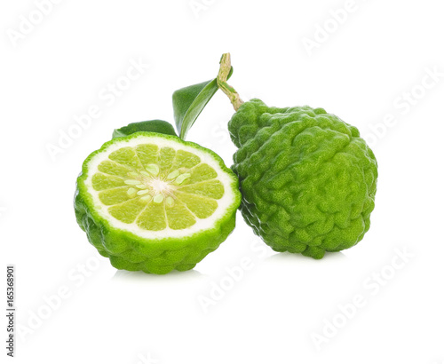 A half and a whole bergamot fruit with leaf isolated on white background.