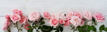 Bouquet Of Beautiful Pink Roses On White Wooden Background.Top View.Copy Space.Banner