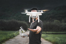 Drone Is Taking Off From Man Hands. Young Man Releasing Aerial Copter To Fly With Small Digital Camera. Modern Technology In Our Life.