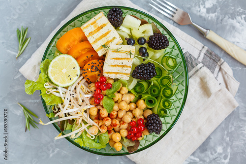 Tuinposter Boeddha buddha bowl of vegetables, chickpeas and tofu.