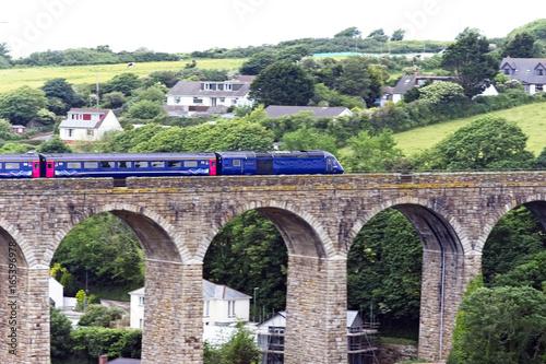 Fotografie, Tablou  An InterCity 125 train (High Speed Train, HST) over the Angarrack Viaduct en route to Paddington, Cornwall, England, UK