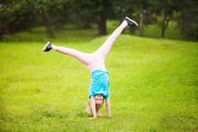 Active Little School Girl Somersault Outdoors