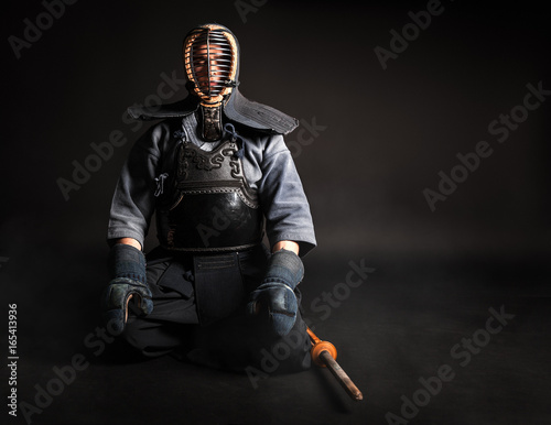 Garden Poster Martial arts Kendo master sitting in traditional armor .