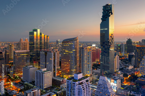 Aerial view of Bangkok modern office buildings, condominium, living place in Bangkok city downtown with sunset scenery, Bangkok is the most populated city in Southeast Asia Poster