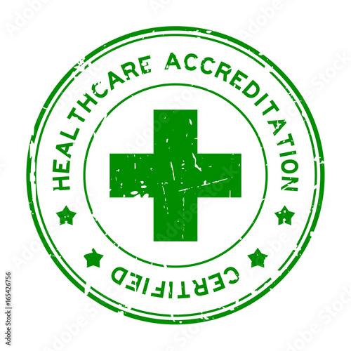 Grunge green healthcare accreditation round rubber seal stamp on white backgroun Canvas Print