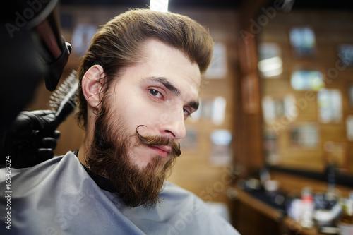 Spoed Foto op Canvas Muziekwinkel Neat man with beard and moustache looking at camera