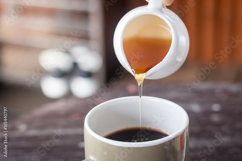 Honey with fresh coffee