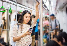 Asian Girl Using Phone On Subway