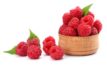 Ripe Raspberries In Wooden Bowl Isolated On White Background Close Up