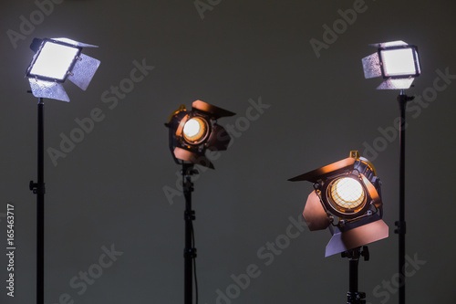 Fotografie, Obraz Two floodlights with halogen lamps and Fresnel lens and two led lighting device