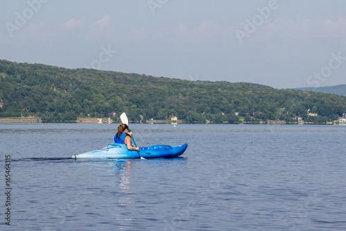 Poster Water Motor sports woman kayaking on a calm lake