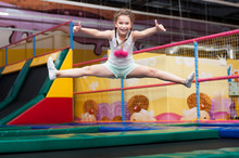 Little Girl Jumping On A Tramp...