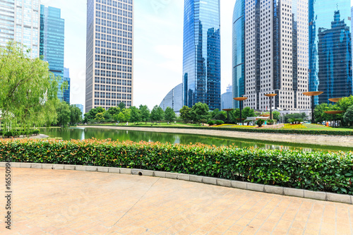 Modern urban architecture and green plants in Shanghai Poster
