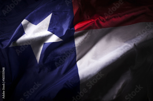 Montage in der Fensternische Texas The Texas state flag waving in shadow
