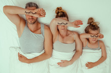 Tired Family In Bed Parents Wi...
