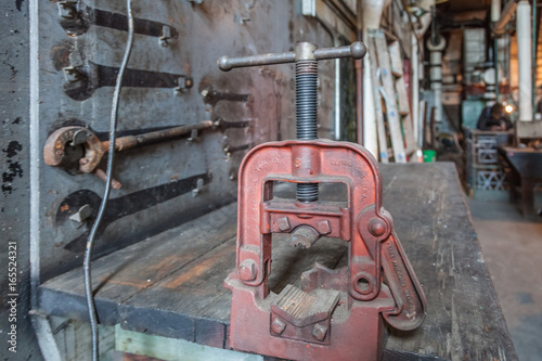 Fotografia, Obraz  vice on a workbench in abandoned steam plant factory
