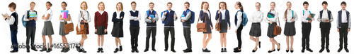 Fotografie, Obraz  Collage of children in different school uniforms on white background
