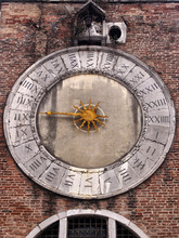 Old Church Clack In Murano Burano Venice With Single Gold Hand And 24 Hour Dial With Roman Numerals In A Brick Tower