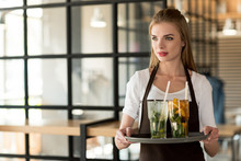 Portrait Of Young Waitress In ...