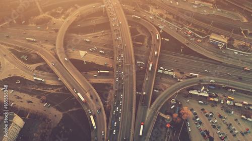 Valokuva  Aerial high drone flight over evening road traffic in Kiev, Ukraine