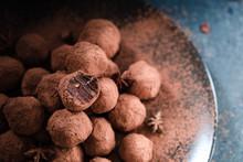 Homemade Fresh Energy Chocolate Raw Balls With Avocado, Dates And Honey On Dark Background