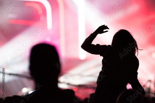 Aluminium Prints Rear view of crowd with arms outstretched at concert