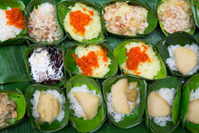 Thai Dessert - Sticky Rice Custard Wrapped In Banana Leaves