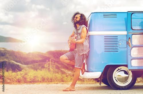 фотография hippie man playing guitar at minivan car on island