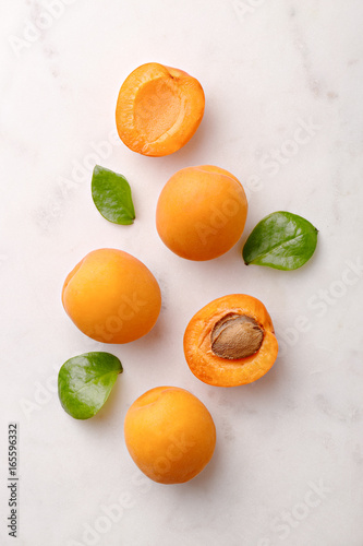 Apricots on marble background viewed from above Canvas Print