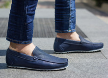 A Man In Blue Moccasins