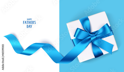 Fotografie, Obraz  Decorative gift box with blue bow and long ribbon
