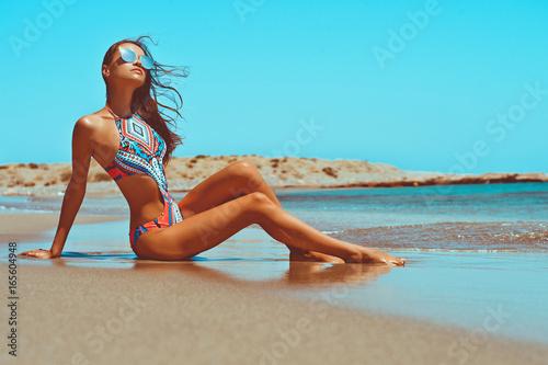 Fotografie, Obraz  Beautiful happy slender woman at sea