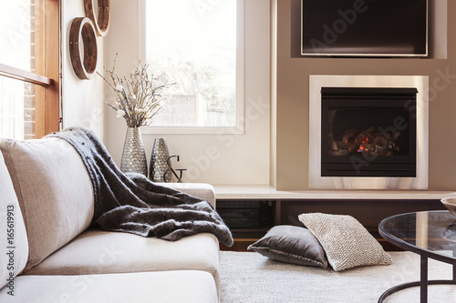 Cuadros en Lienzo Warm inviting interior with gas log fireplace