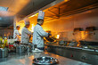 canvas print picture - Chef in restaurant kitchen at stove with pan, doing flambe on food
