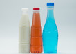 Three modern design bottles of soft drink on white background, just add your own text