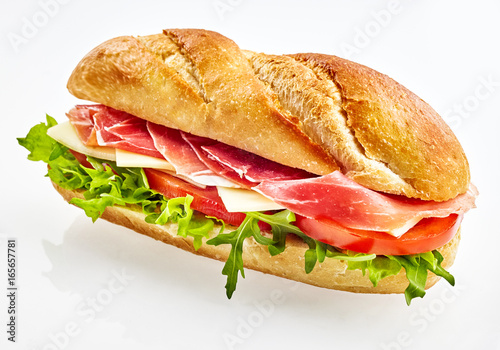 Baguette sandwich with serrano ham, cheese and vegetables Fototapete