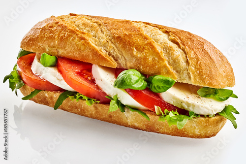 Staande foto Snack Baguette sandwich with cheese, tomato and basil