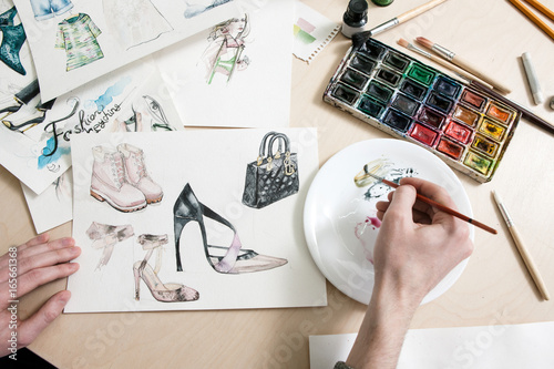 Fashion Designer Mixes Colours Of Paint In Process Of Drawing Fashion Sketches Of Footwear And Clothing Buy This Stock Photo And Explore Similar Images At Adobe Stock Adobe Stock