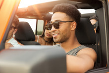 Smiling Young African Man Driving A Car