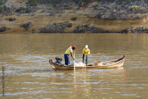 Fotografie, Obraz Two fishermen on the Irrawaddy river, Mandalay, Myanmar, Burma