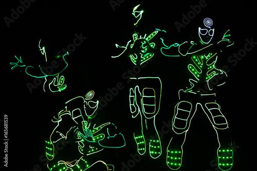 Montage in der Fensternische Karneval dance team in costumes of the LEDs