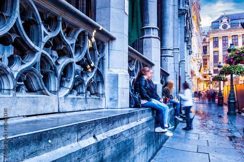 People sitting along street in Brussels, Belgium © James Ser